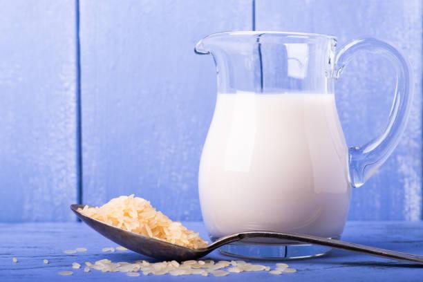 rice and rice milk in the glass jug - caraffa imagens e fotografias de stock