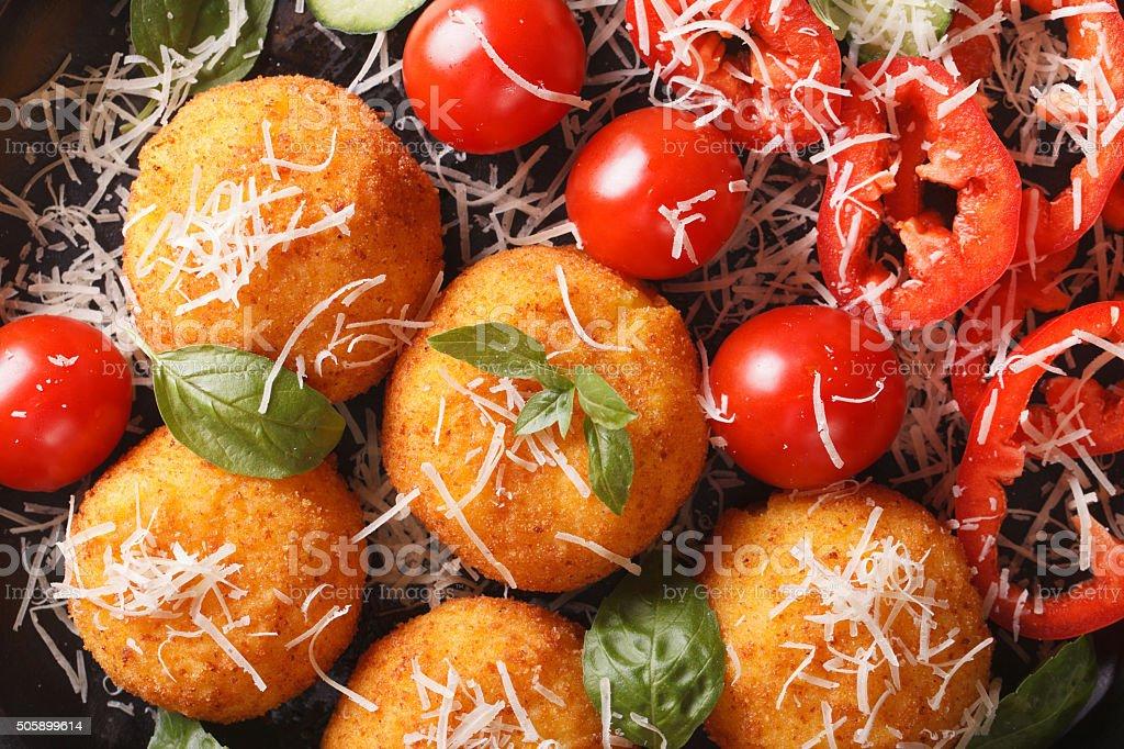 rice balls and salad of fresh vegetables macro. horizontal stock photo