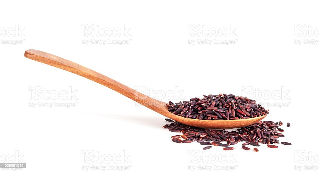 rice berry in wooden spoon isolated on white background stock photo
