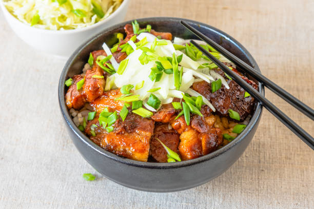 Rice bowl and fried pork belly and  chinese cabbage salad i - traditional Korean dish. stock photo