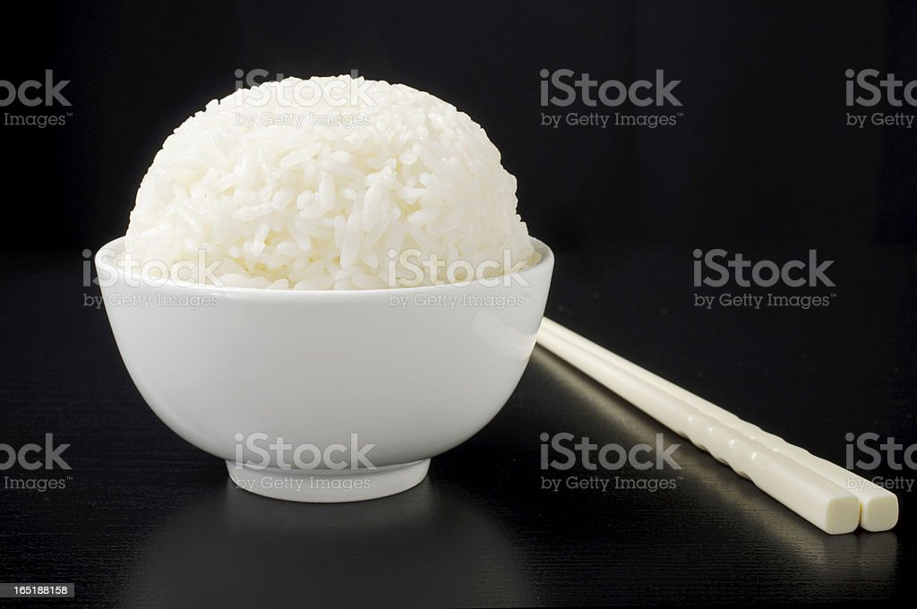 Rice bowl with chopsticks royalty-free stock photo