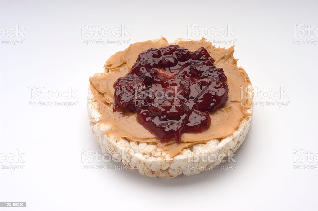 Rice cake with peanut butter and jelly. stock photo