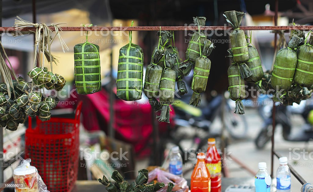 Rice cakes wrapped in banana leaves on the market, Vietnam stock photo