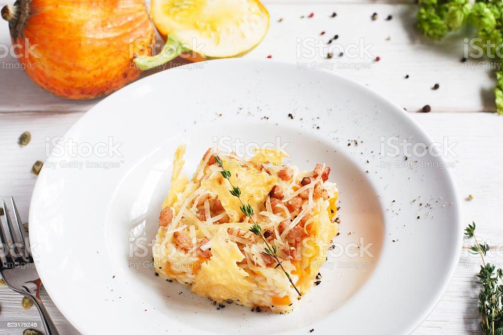 Rice casserole in cheese basket on plate - foto de acervo