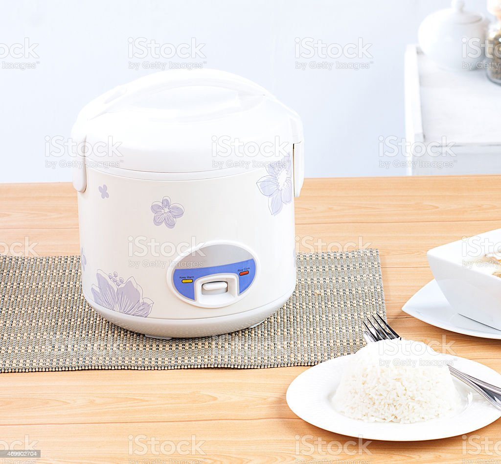 Rice cooking and electric casserole pot stock photo