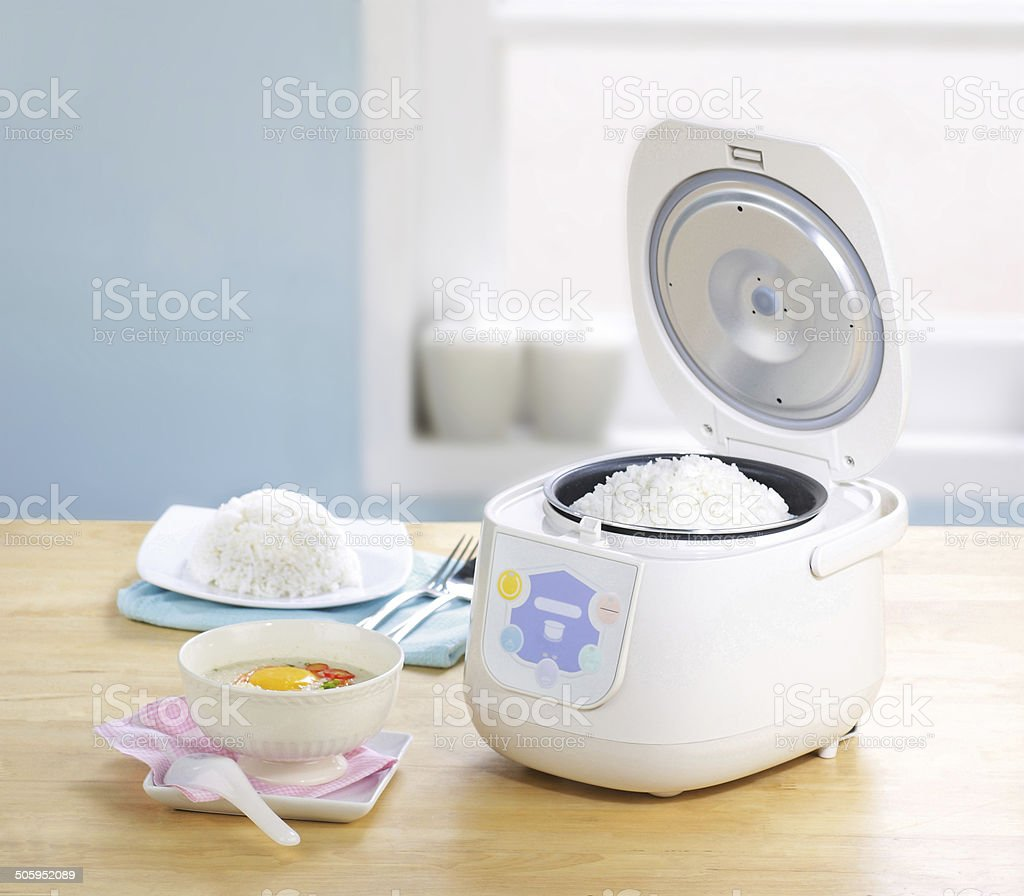 Rice cooking pot in the kitchen interior stock photo