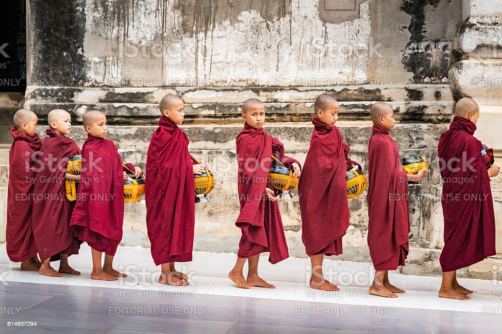 Rice Donation Novice Monks in a Row Old Bagan Myanmar stock photo