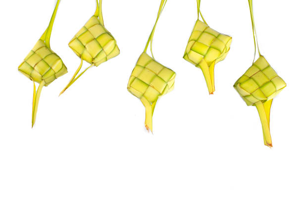 rice dumpling isolated on white background - ketupat stock pictures, royalty-free photos & images