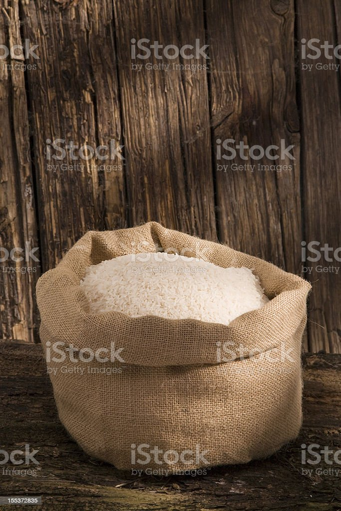 Rice grains in a jute bag stock photo