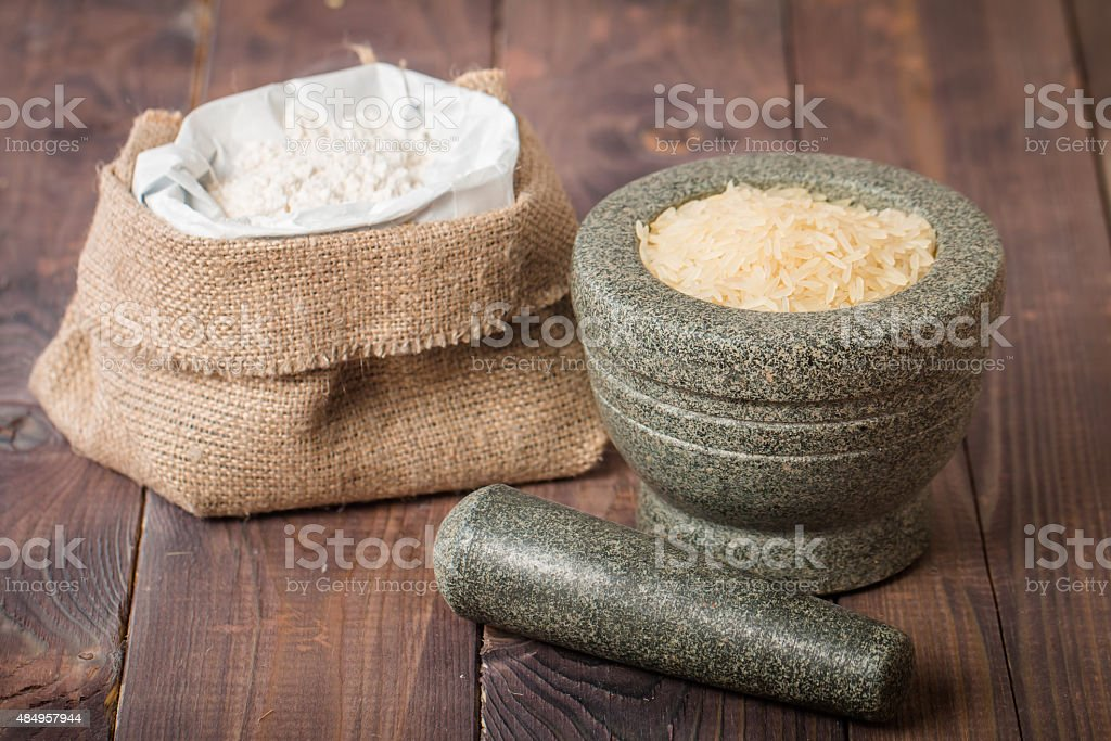 Rice grains in the mortar and flour stock photo
