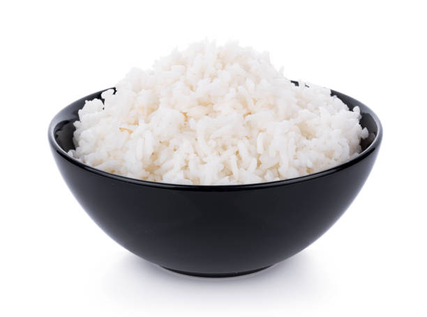 Rice in a bowl on a white background stock photo