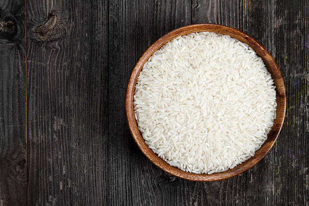 Rice in a wooden bowl stock photo