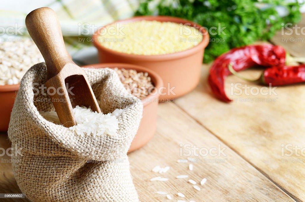 Rice in burlap sack royalty-free stock photo