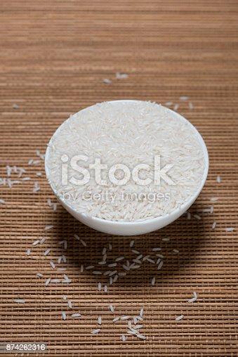 istock Rice in spoon and bowl. Jasmine Rice, Thai Rice, White Rice. 874262316