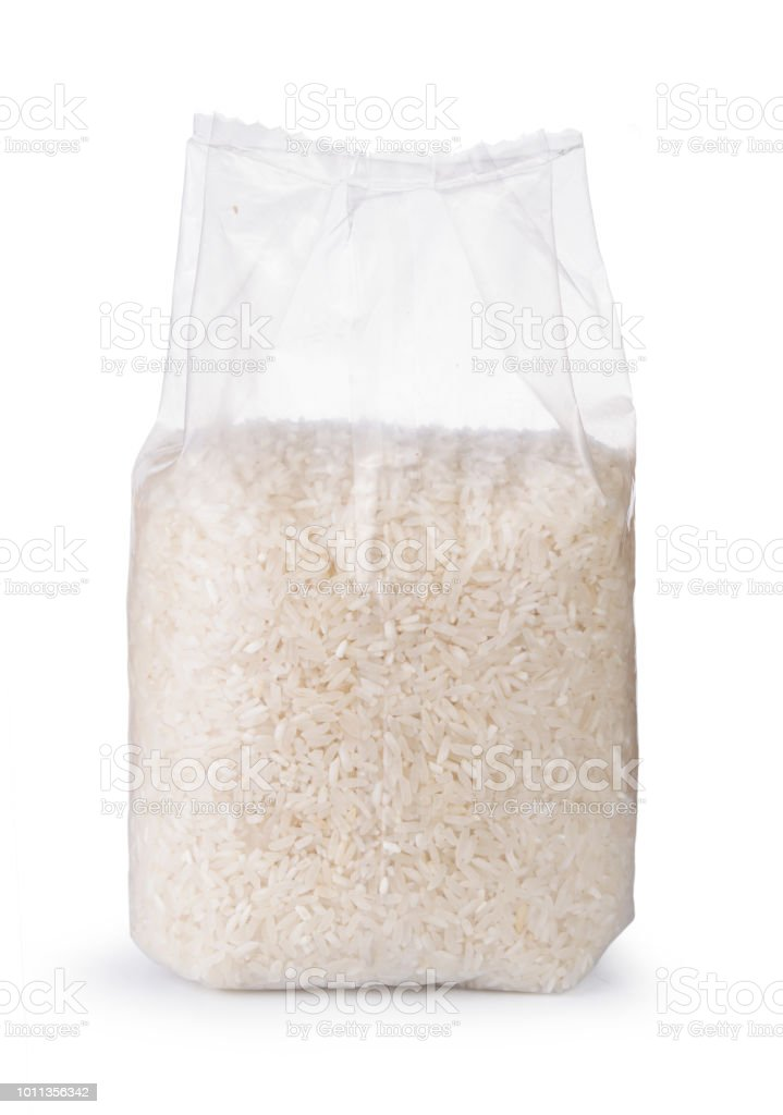 Rice in transparent plastic bag isolated on white background stock photo