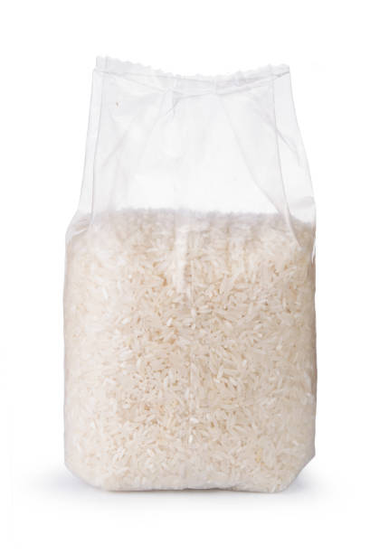 Rice in transparent plastic bag isolated on white background Rice in transparent plastic bag isolated on white background. basmati rice stock pictures, royalty-free photos & images