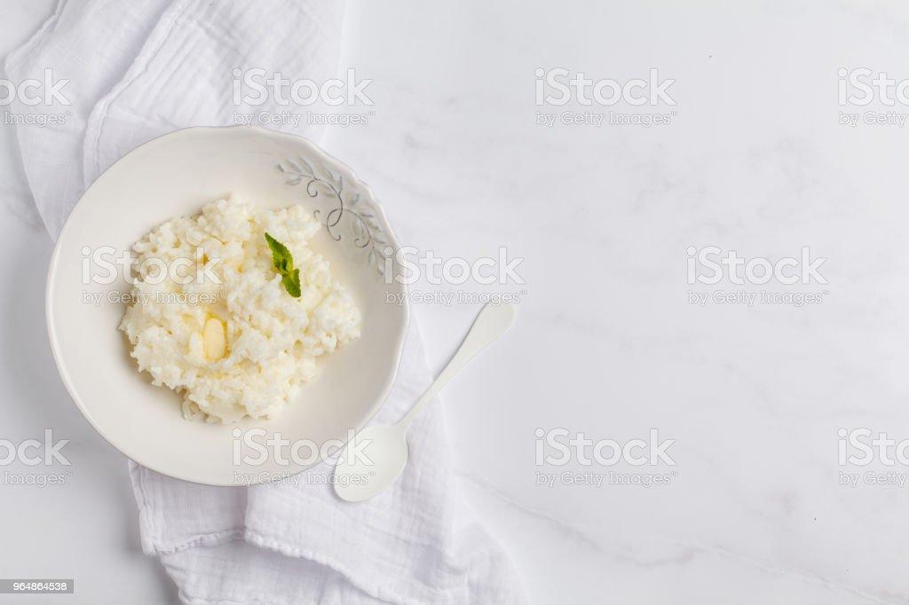 Rice milk porridge for breakfast. White background, top view, copy space. royalty-free stock photo