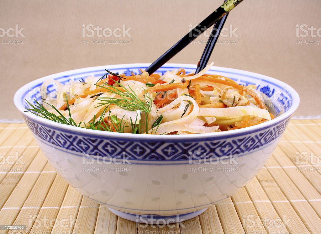 Rice noodle with chicken meat and chopsticks royalty-free stock photo