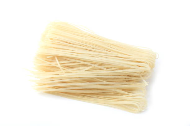 rice noodles on a white background rice noodles on a white background rice noodles stock pictures, royalty-free photos & images
