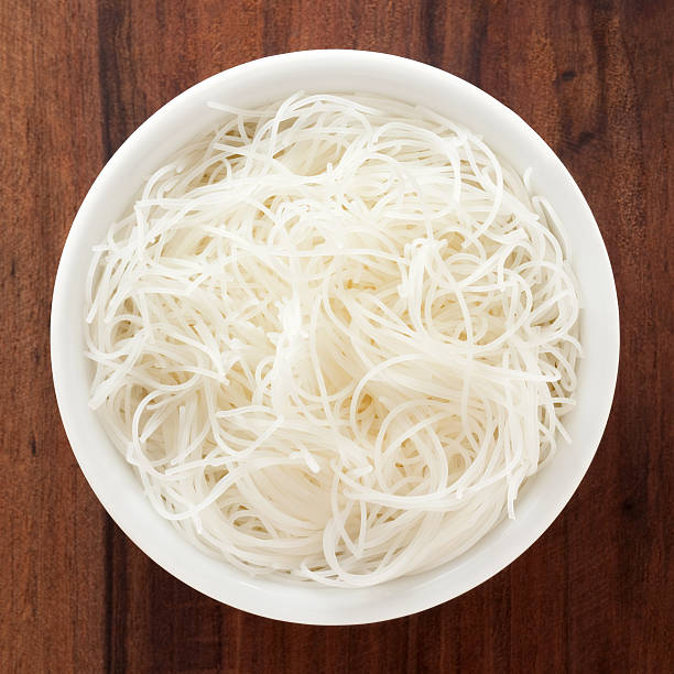 Rice noodles Top view of white bowl full of  rice noodles rice noodles stock pictures, royalty-free photos & images