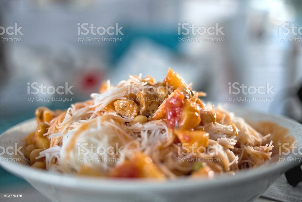 Rice noodles topped with sauce made from chili. stock photo