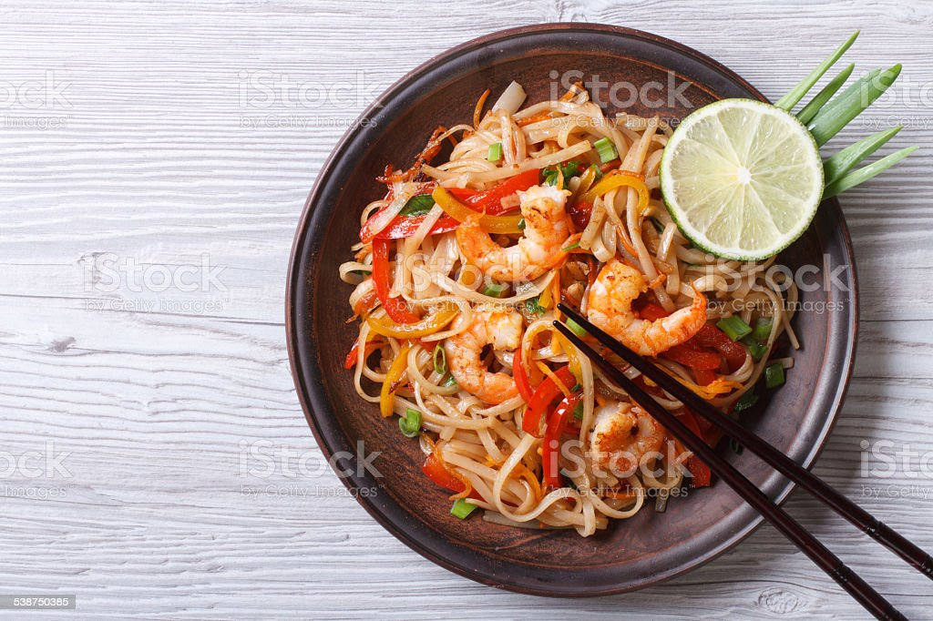 Rice noodles with shrimps and vegetables top view stock photo