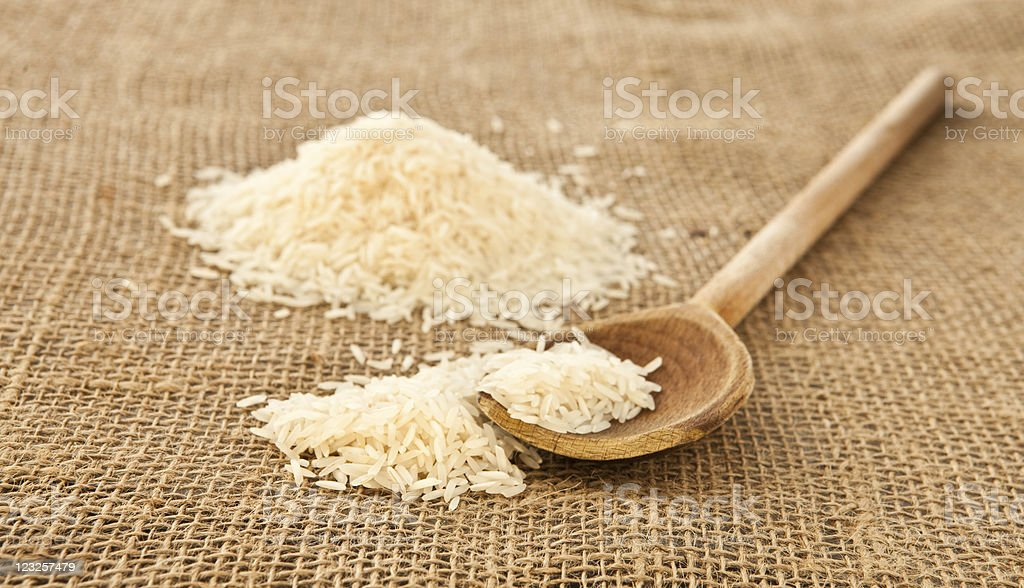 Rice on a wooden spoon stock photo