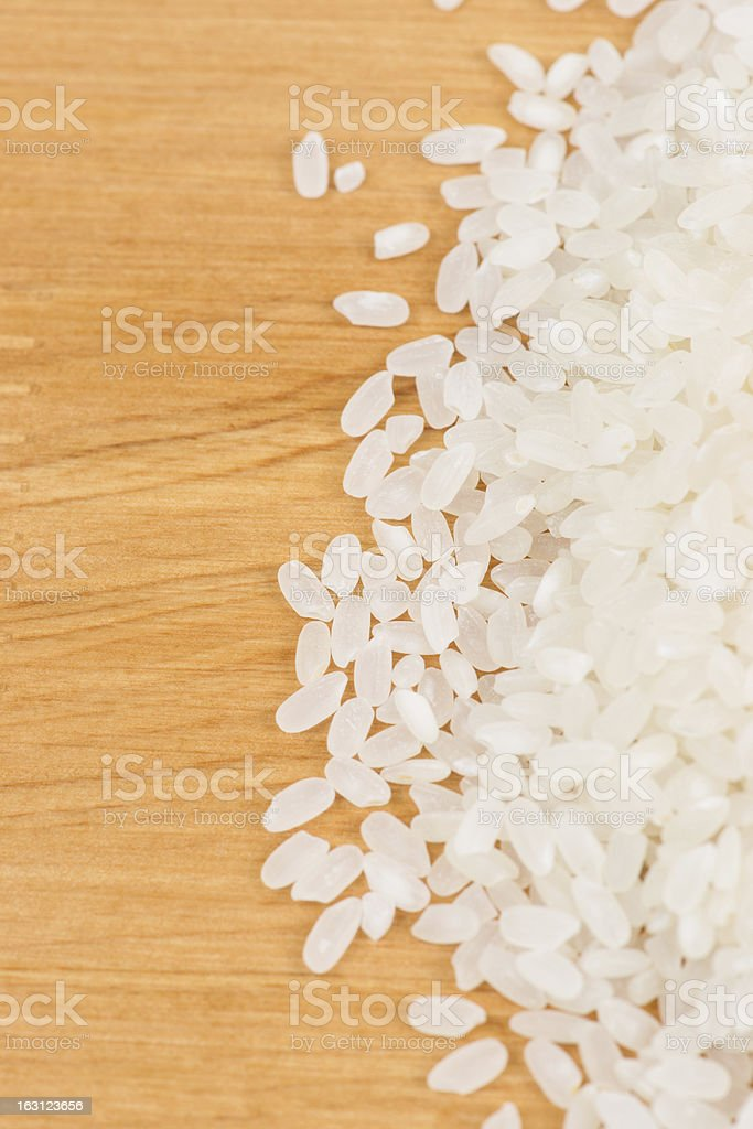 Rice on wooden board royalty-free stock photo