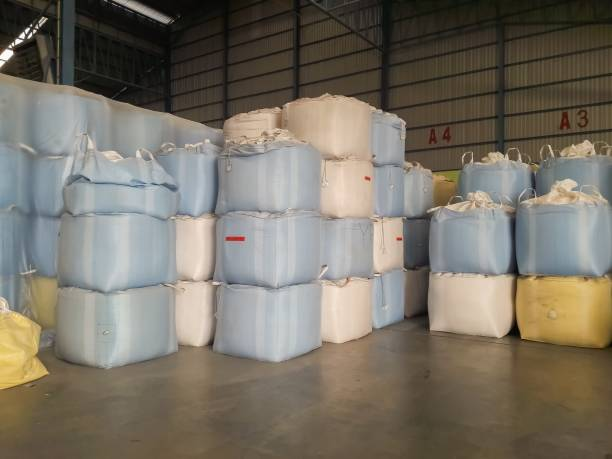 Rice packed in sacks in a rice mill stock photo