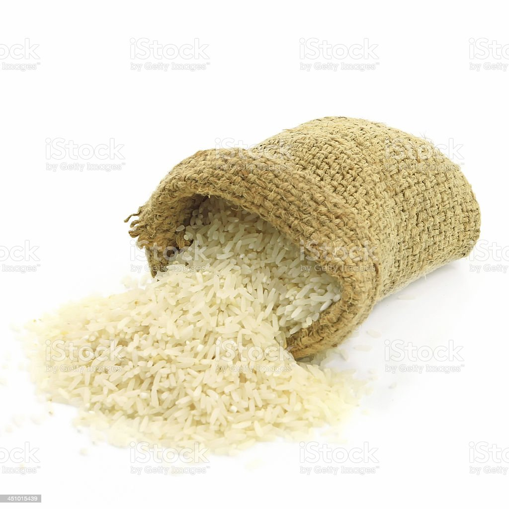 Rice packed in sacks of hemp isolated white background. stock photo