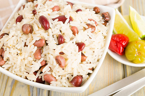 rice & peas - caribbean food stock photos and pictures