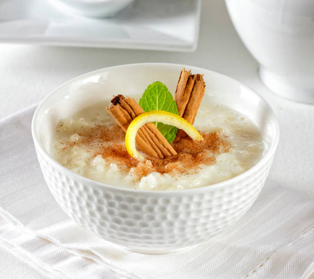 Rice pudding Rice pudding with cinnamon and lemon. arroz stock pictures, royalty-free photos & images