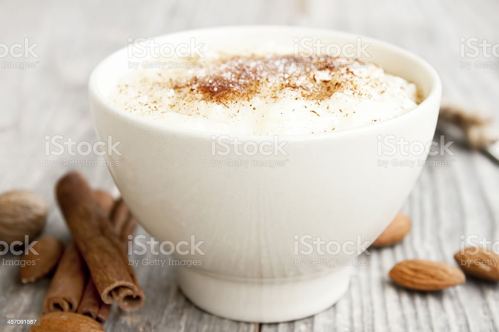 Rice pudding with cinnamon powder stock photo