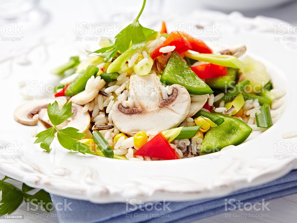 Rice salad with mushrooms and pepper stock photo