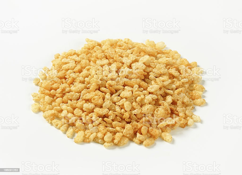 Rice snaps which have been poured onto a white surface stock photo