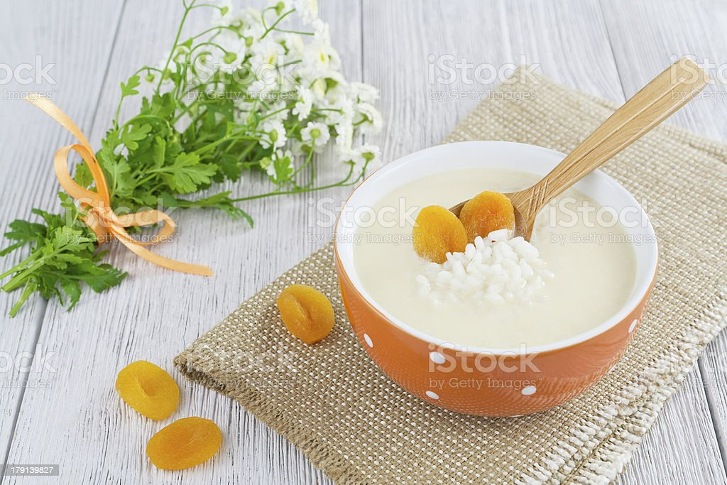 Rice soup with cream and dried apricots royalty-free stock photo