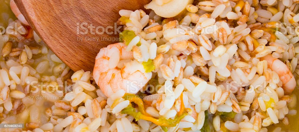 Rice spelled barley shrimp and zucchini stock photo