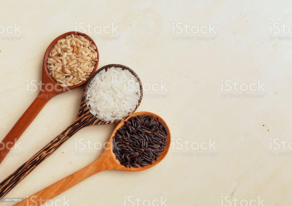 Rice spoon with space on wood background stock photo