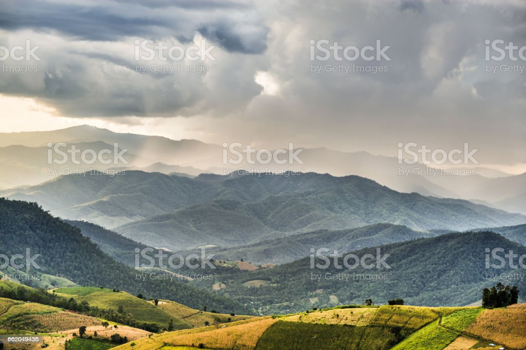 rice terrace and hut on the mountain hill with storm cloud and raining royalty-free stock photo
