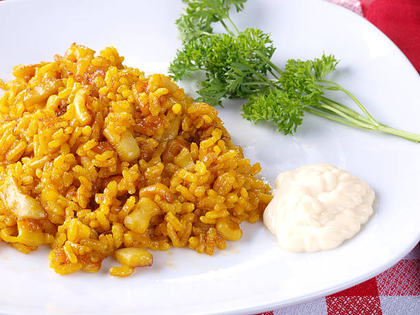 "Arroz a Banda Traditional Valencian Dish.  The Paella is the most worldwide well-known Valencian dish, but the gastronomy in this Spanish Region has a large variety of rice dishes. The ""Arroz A Banda"" is a kind of seafood paella cooked  with seafood  stock. arroz stock pictures, royalty-free photos & images"