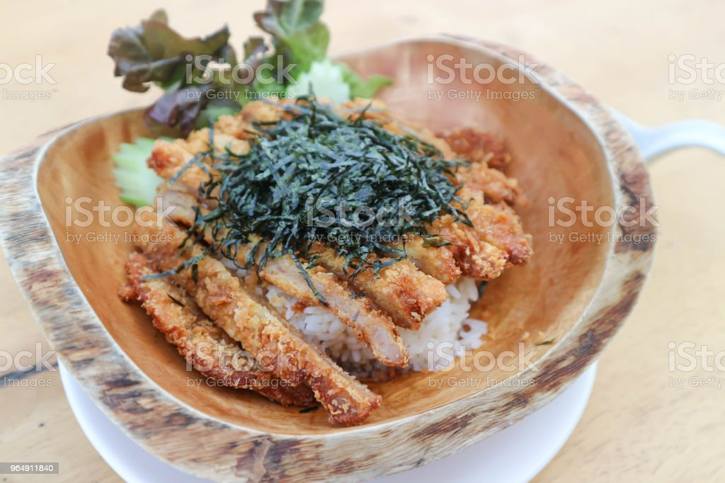 rice topped with fried pork or Tonkatsu royalty-free stock photo