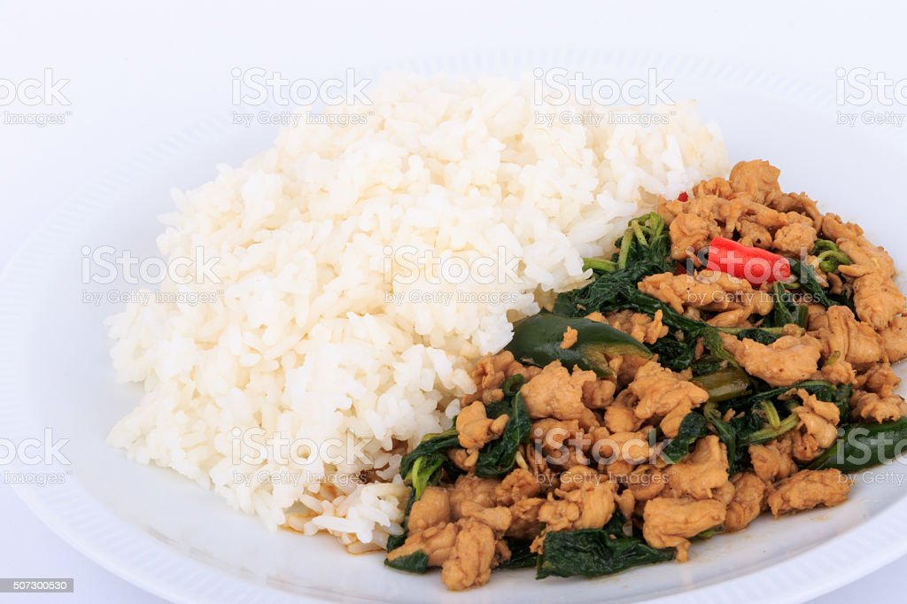 Rice Topped With Stirfried Chicken And Basil On Isolated