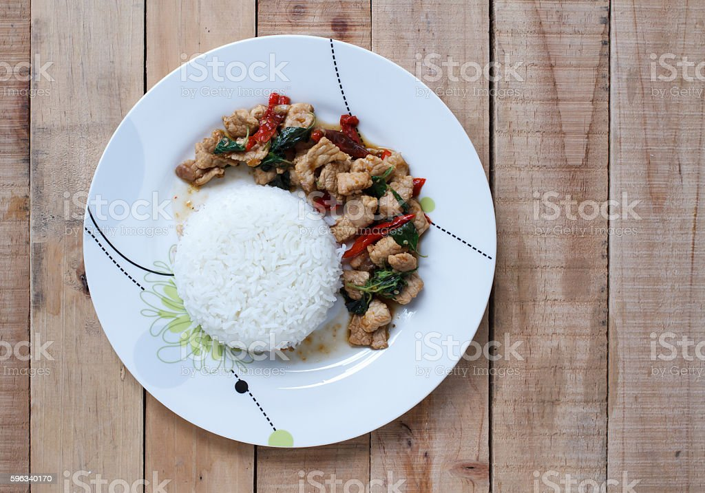 Rice topped with stir-fried pork and basil royalty-free stock photo