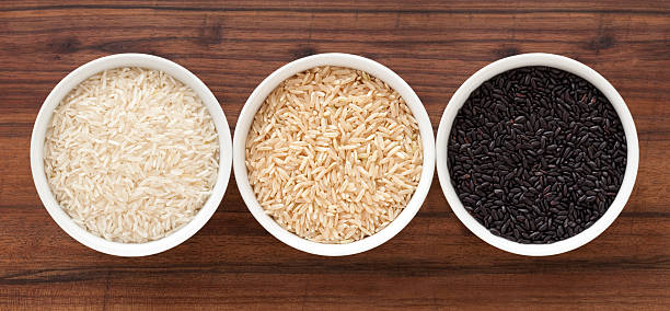Rice varieties Top view of three bowls containing rice varieties (basmati, brown and black) basmati rice stock pictures, royalty-free photos & images
