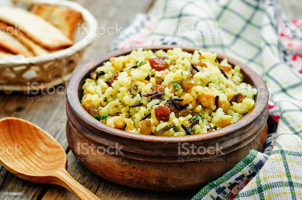rice, wild rice, chickpeas with raisins and herbs stock photo