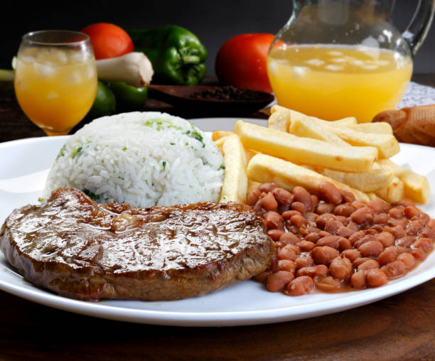 rice with beans and meat - meat plate imagens e fotografias de stock
