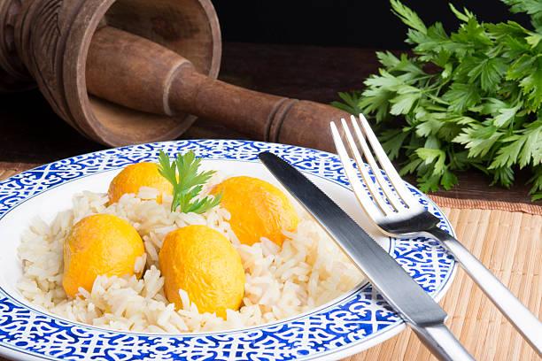 arroz com pequi brasileiro - pequi - fotografias e filmes do acervo