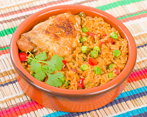 Arroz Con Pollo Arroz Con Pollo - Chicken and rice cooked with sofrito and beer. arroz stock pictures, royalty-free photos & images