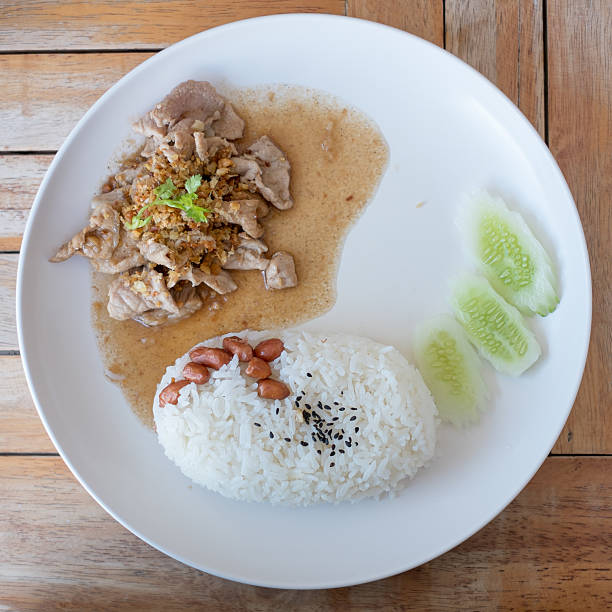 Rice with fried sliced pork with garlic and black pepper. stock photo