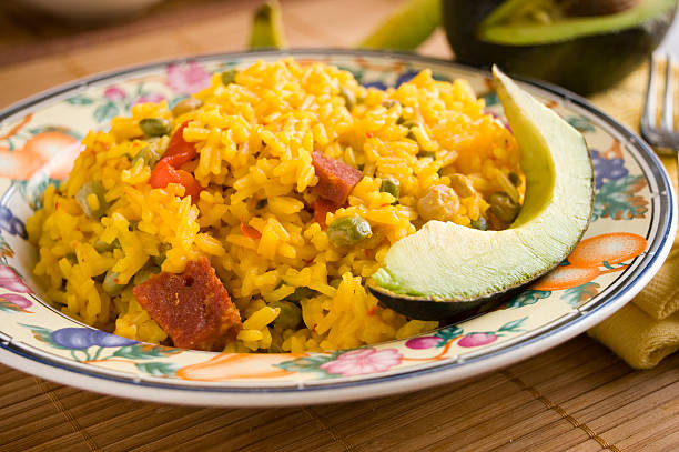 Arroz Con Gandules Traditional Puerto Rican dish. Yellow rice with pigeon peas, pieces of salami, and red pimiento. arroz stock pictures, royalty-free photos & images
